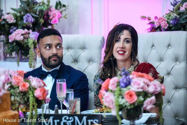 Indian newlyweds sitting on the main table