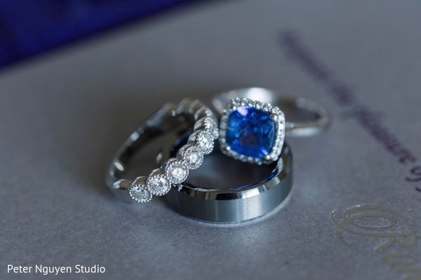 White gold and blue stone Indian wedding rings.