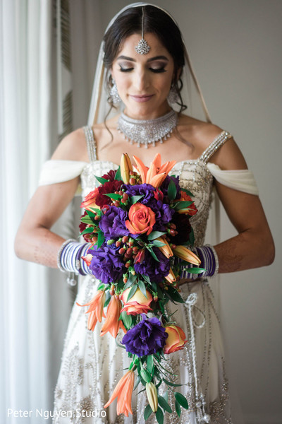 Indian bridal red, coral and purple bouquet.