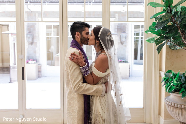 Indian groom kissing the bride capture.