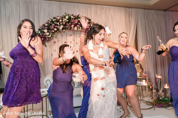 Maharani dancing at reception with bridesmaids.