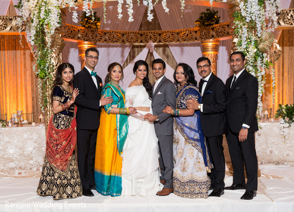 Indian couple with relatives reception photo session.