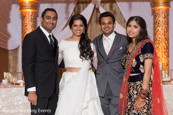 Indian couple next to siblings photo session.