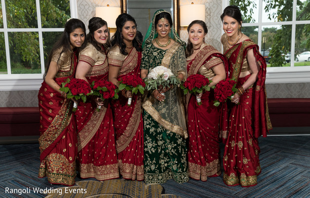 Sweet indian bride with bridesmaids posing for photo shoot