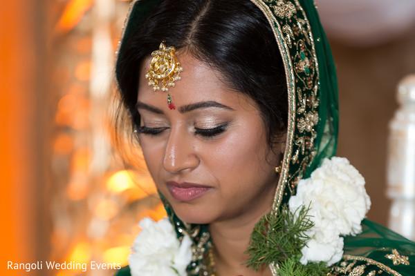 Indian bride with her ceremony kundan tikka.
