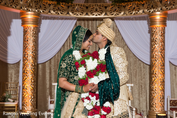 Indian bride and groom kiss photography.