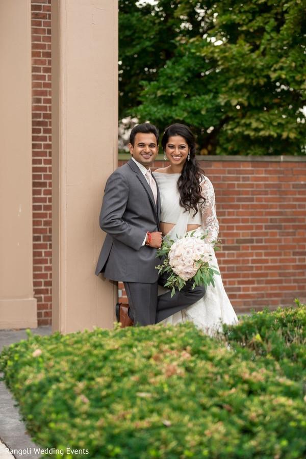 Elegant Indian couple posing outdoors photo session.