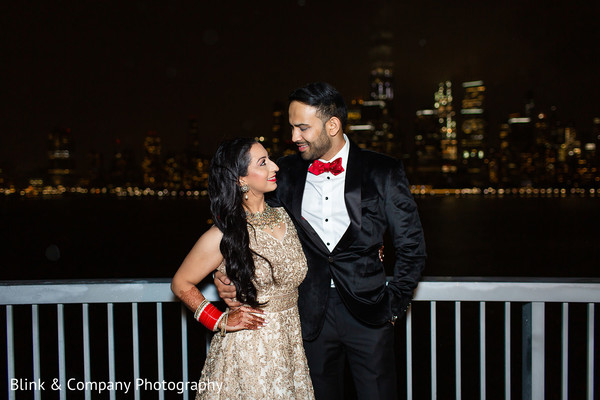 Indian couple on their elegant wedding reception outfits.