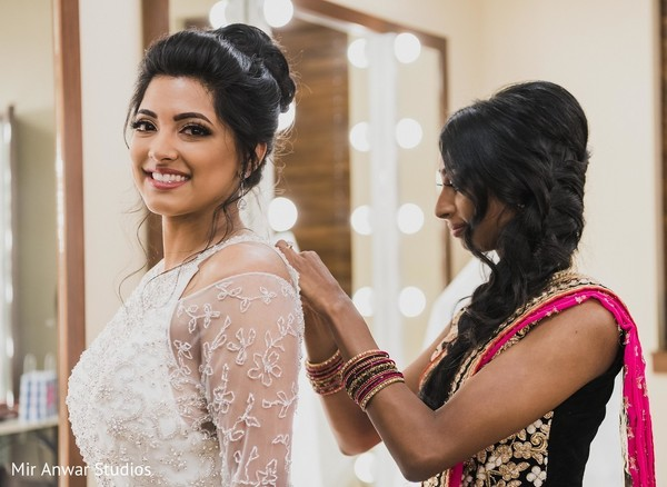Maharani getting her white wedding dress on.