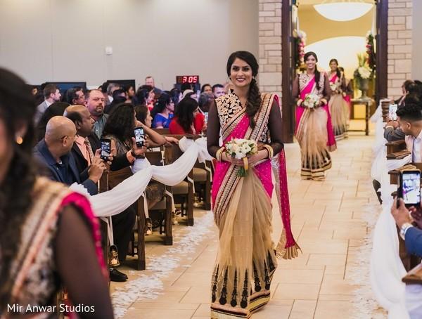 Indian bridesmaids on their golden black pink sari.