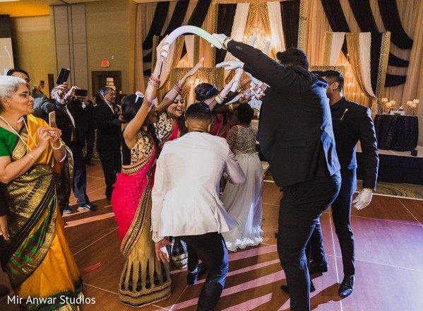 Indian couple making their entrance to reception.