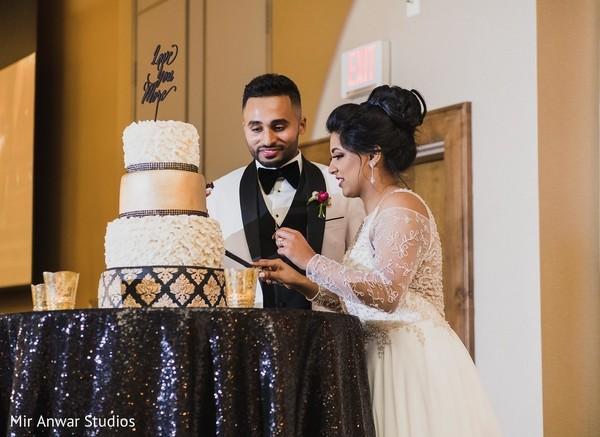 Indian wedding reception Cutting cake scene.