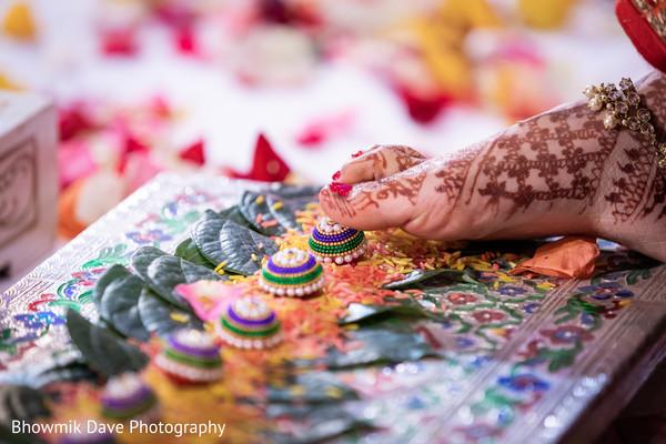 Maharani showing her feet henna art.