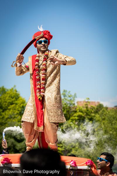 Indian groom on his golden sherwani.