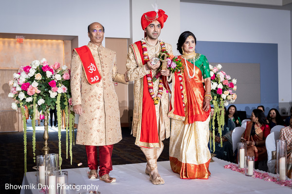 Indian groom entering the ceremony with his family.
