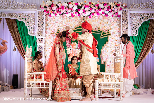 Indian Groom putting flowers garland to his Bride.