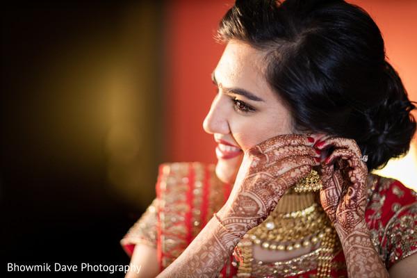 Dazzling indian bride earrings and mehndi