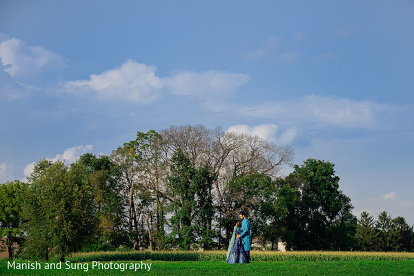 Indian couple embracing in the middle of the field