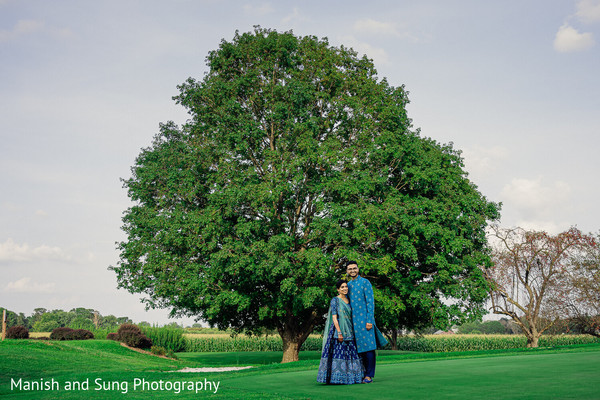 Indian couple posing in front of a tree