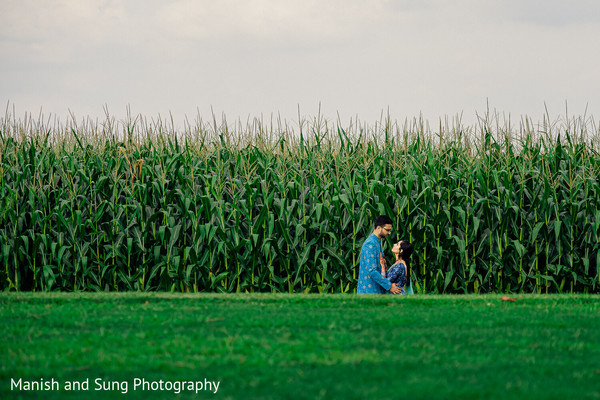 Indian couple sharing a moment in front of a corn field