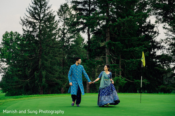 Indian couple walking the golf course hand in hand