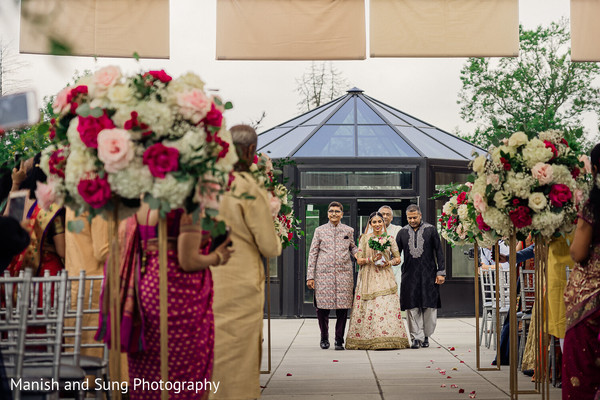 Indian bride making her entrance escorted by her Indian relatives
