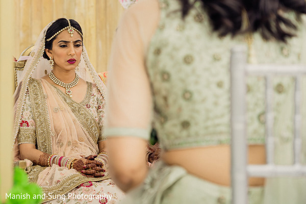 A picture of the Maharani sitting on the wedding stage