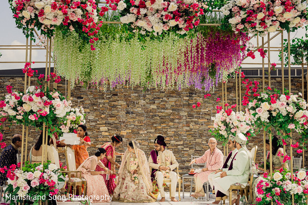 Indian couple change their position on the wedding stage