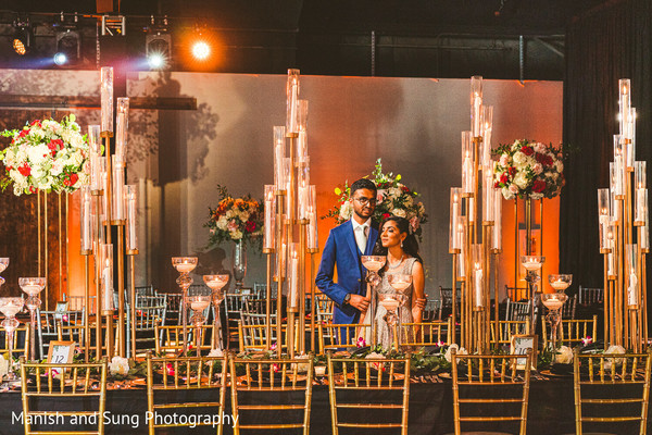 Indian newlyweds alone in the wedding hall