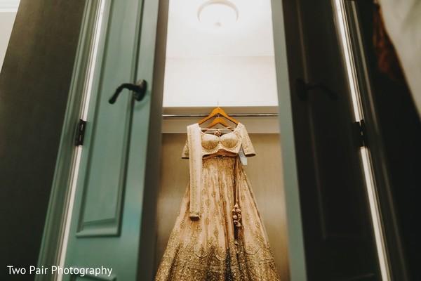 Indian bridal golden and ivory wedding lehenga.
