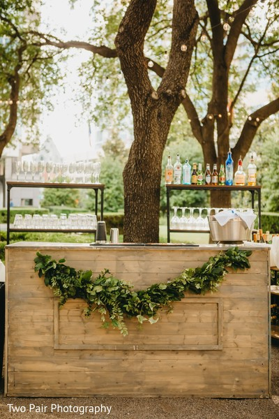 Indian wedding wooden outdoors drinks bar.