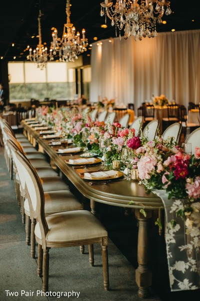 Indian wedding rectangle table flowers centerpiece.