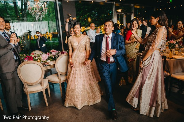 Indian couple making their entrance to reception party.