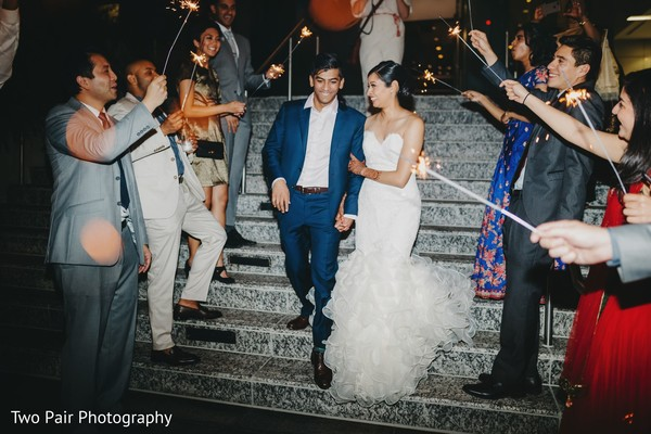 Indian bridesmaids and groomsmen lighting up the couple's way.