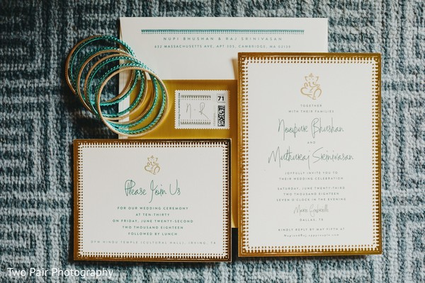 Golden and ivory Indian wedding invitations.