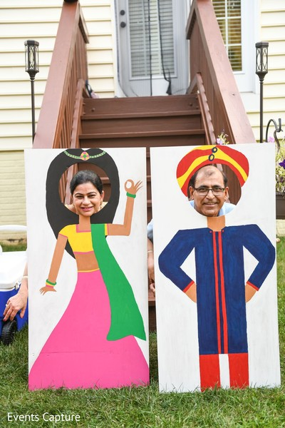 Indian wedding relatives posing at photo booth.