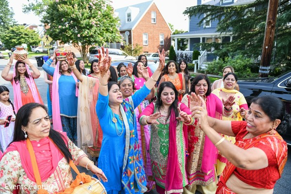 Indian bridesmaids and relative women at pre-wedding rituals.