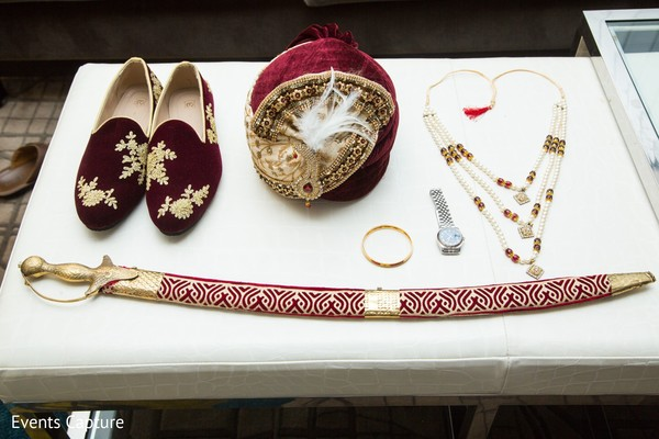 Indian groom's red and golden sword, mojaris, turban and jewelry.