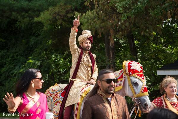 Raja riding his white baraat horse.