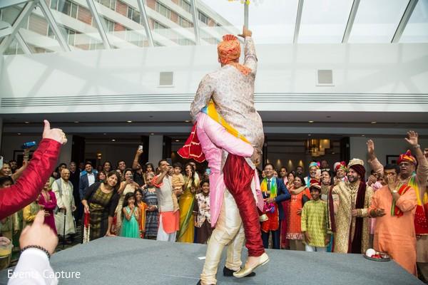 Indian groomsmen performing for raja.