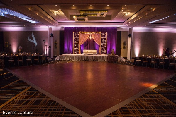 Indian wedding reception stage and dance floor decor.