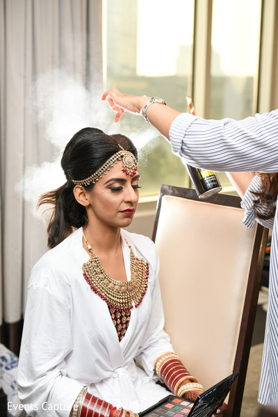 Indian bridal getting her matha patti on and her hair done.