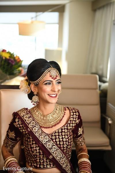 Indian bride wearing her kundan ceremony jewelry.