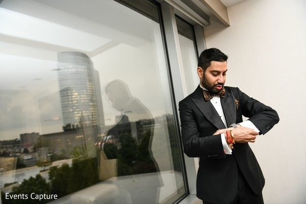 Indian groom on his reception black outfit.