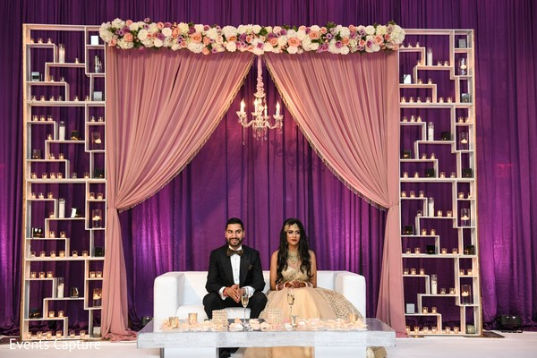 Indian couple at wedding reception stage.