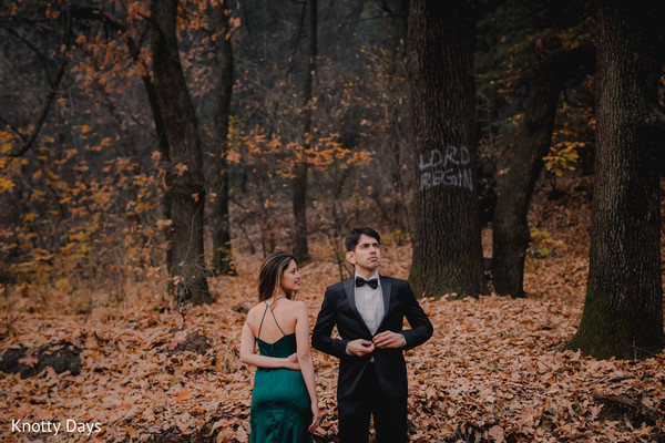 Indian couple  with their green and black reception outfits.