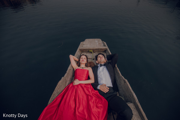 Indian couple posing on a boat capture.