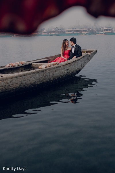 On a wooden boat indian bride and groom photography.