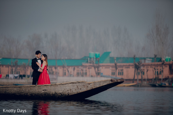 Indian couple holding eachother on a boat.