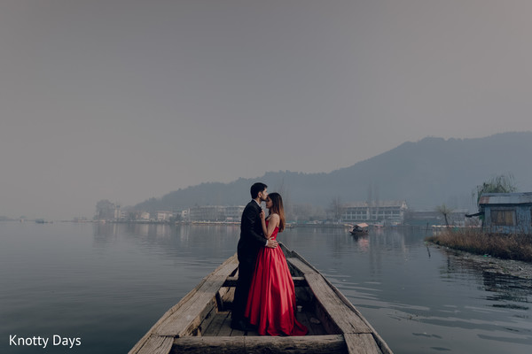 On a boat Indian bride and groom's kiss.